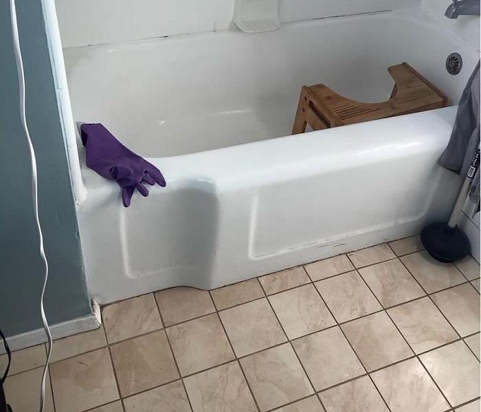 Bath tub and tile flooring cleaned after sewage back up